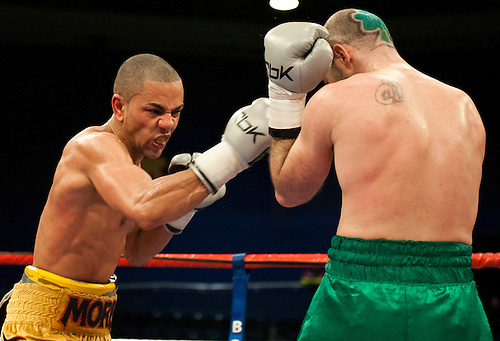 GLASGOW, SCOTLAND - MARCH 10: Gary O'Sullivan (green shorts)  punched by Paul Morby (gold shorts) during a Welterweight contest on the Ricky Burns undercard at the Braehead Arena on March 10, 2012 in Glasgow, Scotland. (Photo by Rob Casey/Getty Images)