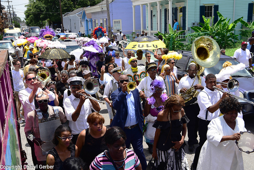 Friends, family and baby dolls say goodbye as they lay Tee Eva Perry to rest with a funeral and secondline in Central City. James Andrews