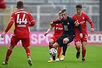 v.li.: Kilian Senkbeil (Bayern München, FCB, 13) Marvin Pourie (Kaiserslautern, 9) Angelo Stiller (Bayern München, FCB, 38) im Zweikampf, Duell, duel, tackle, Dynamik, Action, Aktion beim Spiel in der 3. Liga, FC Bayern München II -1. FC Kaiserslautern.<br /> <br /> Foto © PIX-Sportfotos *** Foto ist honorarpflichtig! *** Auf Anfrage in hoeherer Qualitaet/Aufloesung. Belegexemplar erbeten. Veroeffentlichung ausschliesslich fuer journalistisch-publizistische Zwecke. For editorial use only. DFL regulations prohibit any use of photographs as image sequences and/or quasi-video.
