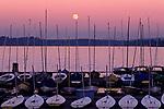 Sunset over Lake Washington with marina and sailboats with moonrise over Lake Washington Seattle Washington State USA