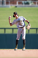 Surprise Saguaros shortstop Cole Tucker (2), of the Pittsburgh Pirates organization, throws around the infield during an Arizona Fall League game against the Salt River Rafters at Salt River Fields at Talking Stick on November 5, 2018 in Scottsdale, Arizona. Salt River defeated Surprise 4-3 . (Zachary Lucy/Four Seam Images)