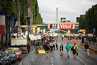 before the final podium ceremony on the famous Champs Elysées, Chris Froome (GBR/SKY) first rides 'anonymously' back to the teambus, not surrounded by any press mob...<br /> <br /> stage 21: Sèvres - Champs Elysées (109km)<br /> 2015 Tour de France