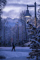 Students arrive at UAA's Administration and Humanities Building in the pre-dawn winter light after a snowfall.