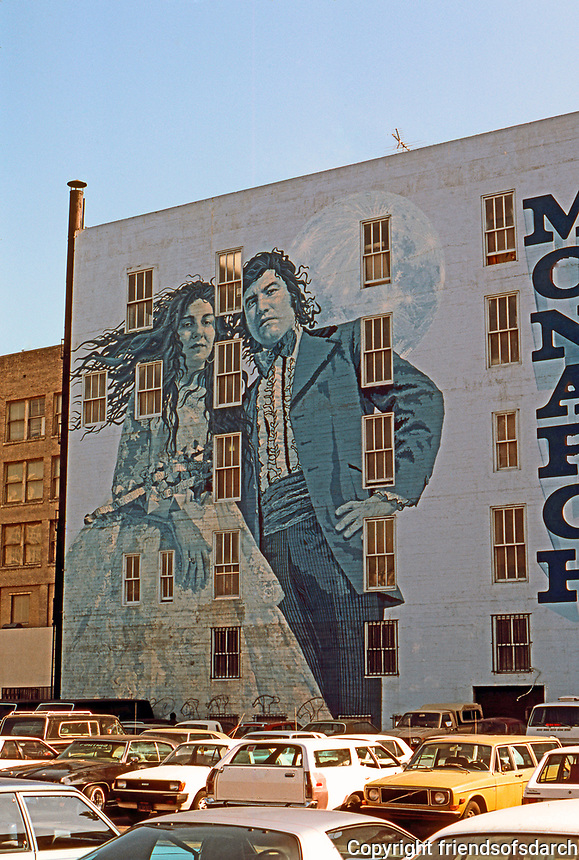 """Los Angeles: Mural on South Broadway, 1975. """"Bride and Groom"""", Kent Twitchell.  Photo '84."""
