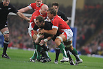 Jimmy Cowan is tackled by Tom Shanklin & Andy Powell. Wales V New Zealand. Invesco Perpetual Series 2008. 22/11/2008. © Ian Cook IJC Photography iancook@ijcphotography.co.uk www.ijcphotography.co.uk