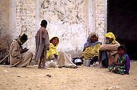 A familiy in front of the Sufi-Shrine near Chenepir in the desert of Cholistan. The people came from far away for praying at the shrine.<br /> 16.2.2001, Chenepir/Punjab<br /> Copyright: Christian-Ditsch.de<br /> [Inhaltsveraendernde Manipulation des Fotos nur nach ausdruecklicher Genehmigung des Fotografen. Vereinbarungen ueber Abtretung von Persoenlichkeitsrechten/Model Release der abgebildeten Person/Personen liegen nicht vor. NO MODEL RELEASE! Nur fuer Redaktionelle Zwecke. Don't publish without copyright Christian-Ditsch.de, Veroeffentlichung nur mit Fotografennennung, sowie gegen Honorar, MwSt. und Beleg. Konto: I N G - D i B a, IBAN DE58500105175400192269, BIC INGDDEFFXXX, Kontakt: post@christian-ditsch.de<br /> Bei der Bearbeitung der Dateiinformationen darf die Urheberkennzeichnung in den EXIF- und  IPTC-Daten nicht entfernt werden, diese sind in digitalen Medien nach §95c UrhG rechtlich geschuetzt. Der Urhebervermerk wird gemaess §13 UrhG verlangt.]