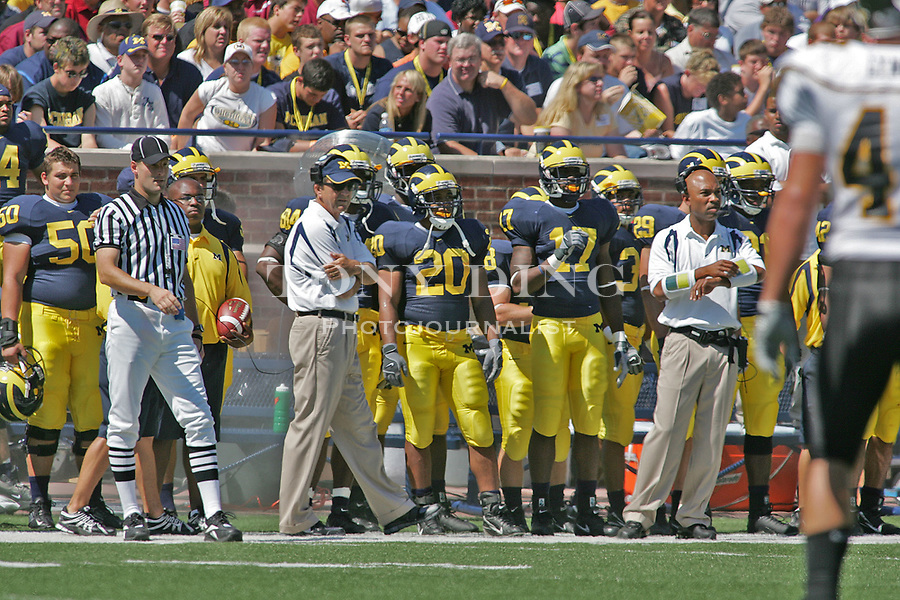 1 September 2007: Michigan football head coach Lloyd Carr, center left, stands with running back Mike Hart (20) in the 2007 season opener college football game between the Michigan Wolverines and Appalachian State Mountaineers at Michigan Stadium in Ann Arbor, MI. Hart started the game but was on the sidelines for the rest of the first half as No. 5 ranked Michigan trailed their Division I-AA opponent.