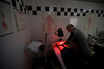 Tranmere Rovers Club Physiotherapist Les Parry, 10/03/2008. Prenton Park, League One. Tranmere Rovers' club physio Les Parry in the club's treatment room using an infra-red lamp to treat one of the club's youth team players for a back injury. Les Parry has been the club physiotherapist since 1993 and recently completed 800 games with the club. At the time he was also working on completing his PhD at Liverpool John Moores University. Photo by Colin McPherson.