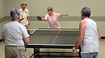 Mildred Swiec, left, and Shirley Ling play ping pong against Wayne Lenhares and Vernon Moss at the Carson City Senior Citizen Center in Carson City, Nev., on Wednesday, Aug. 22, 2012.<br /> Photo by Cathleen Allison/Nevada Photo Source