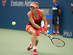 Simone Halep (ROU) splits the first two sets with Victoria Azarenka (BLR) 3-6, 6-4 at the US Open in Flushing, NY on September 9, 2015.
