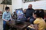 Family of Palestinian prisoner in Israeli jails Mohammed al-Halabi, sit inside their home at Gaza City on April 22, 2021. Palestinian charity worker Mohammed Halabi was seized by Israeli forces on 15 June 2016, he has been brought 119 times to Israeli court during the three years of detention. According to Palestinian estimates, there are 4,400 Palestinian detainees in Israeli prisons, including 39 women and 155 children, and around 350 being held under Israel's administrative detention policy, which allows holding Palestinians without charge or trial. Photo by Mahmoud Ajjour