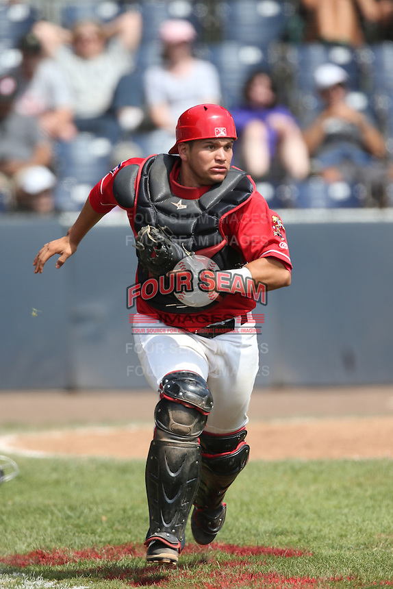 Kevin Garcia (30) of the Vancouver Canadians runs to back up first base during a game against the Eugene Emeralds at Nat Bailey Stadium on July 22, 2015 in Vancouver, British Columbia. Vancouver defeated Eugene, 4-2. (Larry Goren/Four Seam Images)
