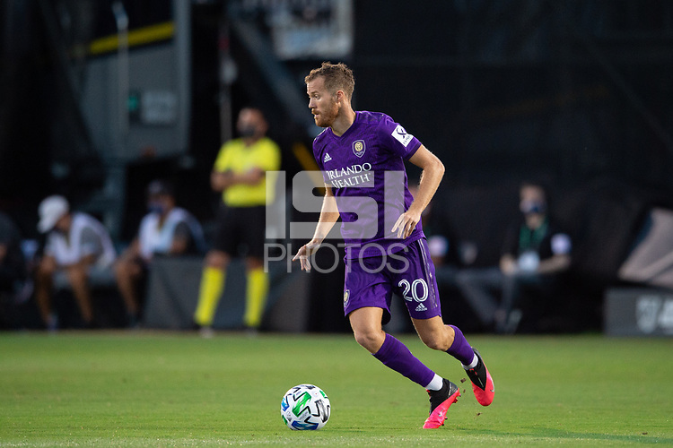 LAKE BUENA VISTA, FL - JULY 25: Oriol Rosell #20 of Orlando City SC dribbles the ball during a game between Montreal Impact and Orlando City SC at ESPN Wide World of Sports on July 25, 2020 in Lake Buena Vista, Florida.