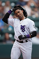 Yoelqui Cespedes (15) of the Winston-Salem Dash returns to the dugout after scoring a run during the game against the Greensboro Grasshoppers at Truist Stadium on June 19, 2021 in Winston-Salem, North Carolina. (Brian Westerholt/Four Seam Images)
