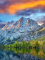 Silver Lake reflection with fall colored cottonwood trees and sunrise. California. Sky has been added.