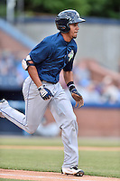 Columbia Fireflies third baseman J.C. Rodriguez (13) runs to first base during a game against the Asheville Tourists at McCormick Field on June 17, 2016 in Asheville, North Carolina. The Tourists defeated the Fireflies 6-2. (Tony Farlow/Four Seam Images)
