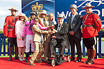 Jockey Patrick Husbands, owners and trainers celebrates his victory with Lieutenant Governor David Onley at the 155th Queen's Plate at Woodbine Race Course in Toronto, Canada on July 06, 2014.