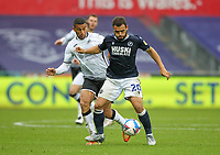 3rd October 2020; Liberty Stadium, Swansea, Glamorgan, Wales; English Football League Championship, Swansea City versus Millwall; Mason Bennett of Millwall controls the ball while under pressure from Ben Cabango of Swansea City