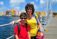2 August 2009: Sally and Josh pose on the Queen Emma floating bridge in Willemstad, the capital city of Curacao. Located in the southern Caribbean, off the coast of Venezuela, Curacao is known for its tourism, excellent scuba diving and snorkeling.  Mandatory Credit: Ed Wolfstein Photo