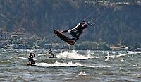 Action Photo of kite boarders  on Okanagan Lake, British Columbia.