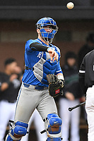 Catcher Kole Cottam (13) of the Kentucky Wildcats in a game in the rain against the University of South Carolina Upstate Spartans on Saturday, February 17, 2018, at Cleveland S. Harley Park in Spartanburg, South Carolina. Kentucky won, 6-5, in 10 innings. (Tom Priddy/Four Seam Images)