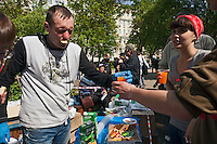 Moscow, Russia, 15/05/2012..A protester with a slice of apple in his mouth hands out food at a makeshift kitchen in Chistiye Prudy, or Clean Ponds, as a Moscow court ordered the eviction of some 200 opposition activists who have set up camp in the city centre park.