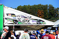 Oct. 5, 2012; Mohnton, PA, USA: Fans surround the pit of NHRA funny car driver Mike Neff during qualifying for the Auto Plus Nationals at Maple Grove Raceway. Mandatory Credit: Mark J. Rebilas-