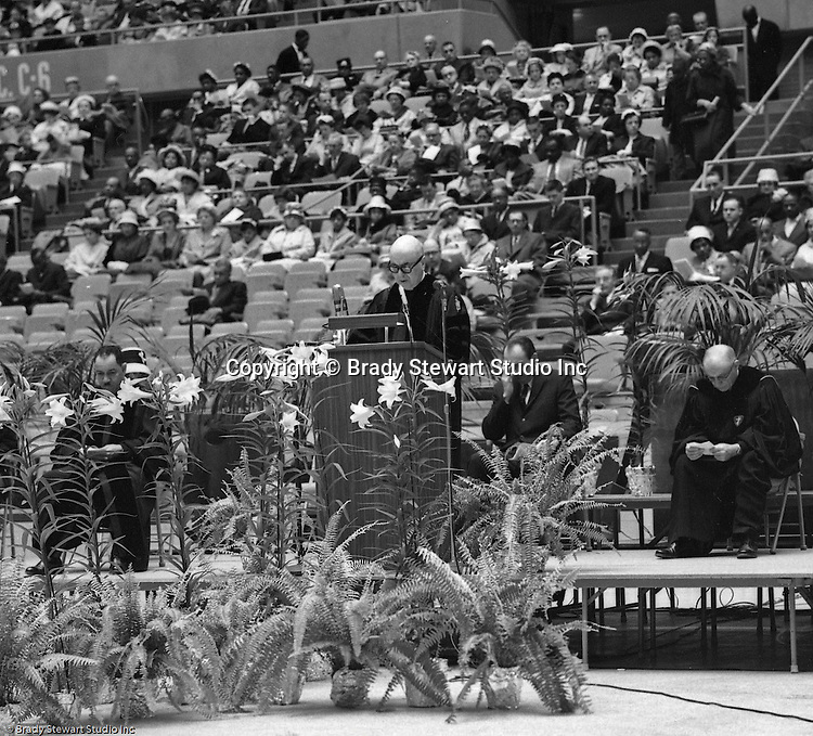 Pittsburgh PA:  View of a speaker at the annual Council of Churches Easter Sunrise Services held at the Civic Arena.  The Council of Churches staged the event that included members of local Catholic, Presbyterian, Lutheran, Baptist, and other denominations in the Pittsburgh Area.  This year the roof was not opened due to weather.<br /> The Council of Churches was a merger of three local groups; the Allegheny County Sabbath School Association, the Pittsburgh Council of Churches, and the Council of Weekday Religious Education.  The council's objection was to better relate and understand other religions including the local Jewish, African American, Catholic and Christian churches in the downtown Pittsburgh area.