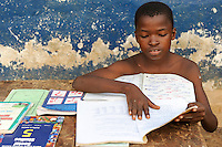 SIERRA LEONE, fishing village River No. 2, boy Nelson 12 years doing home works for school / SIERRA LEONE , Fischerdorf River No. 2 am Western Area National Park  , Junge  Nelson 12 Jahre, bei Schularbeiten