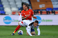 4th May 2021; Kenilworth Road, Luton, Bedfordshire, England; English Football League Championship Football, Luton Town versus Rotherham United; Glen Rea of Luton Town tackles Ben Wiles of Rotherham United