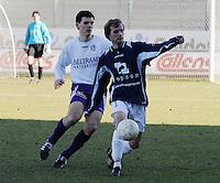 SWI Harelbeke - BS Poperinge ..Tim Pylyser aan de bal voor Pieter-Jan Ruysschaert (links)..foto VDB / BART VANDENBROUCKE