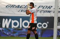 MANIZALES - COLOMBIA, 16-01-2021:Santiago Londoño guardameta de Envigado F.C. se lamenta por su error.Millonarios  y Envigado F.C. en partido por la fecha 1 de la Liga BetPlay DIMAYOR 2021 jugado en el estadio Palogrande de la ciudad de Manizales. /<br /> Santiago Londoño goalkeeper of Envigado F.C. he regrets his mistake.Millonarios  and Envigado F.C. in match for the date 1 as part of BetPlay DIMAYOR League 2021 played at Palogrande stadium in Manizales city.  Photo: VizzorImage / John Jairo Bonilla / Contribuidor