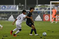 SAN JOSE, CA - SEPTEMBER 13: Oswaldo Alanis passes the ball under pressure from Efrain Alvarez #26 of the Los Angeles Galaxy during a game between Los Angeles Galaxy and San Jose Earthquakes at Earthquakes Stadium on September 13, 2020 in San Jose, California.