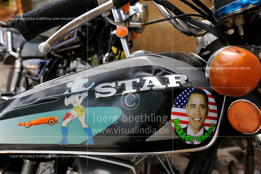 "Westafrika Mali Bamako , Motorrad Tank mit Barack Obama Aufkleber cowgirl und US Flagge  | .Africa Mali Bamako , bike with Barack Obama und US flag sticker | [ copyright (c) Joerg Boethling / agenda , Veroeffentlichung nur gegen Honorar und Belegexemplar an / publication only with royalties and copy to:  agenda PG   Rothestr. 66   Germany D-22765 Hamburg   ph. ++49 40 391 907 14   e-mail: boethling@agenda-fototext.de   www.agenda-fototext.de   Bank: Hamburger Sparkasse  BLZ 200 505 50  Kto. 1281 120 178   IBAN: DE96 2005 0550 1281 1201 78   BIC: ""HASPDEHH"" ,  WEITERE MOTIVE ZU DIESEM THEMA SIND VORHANDEN!! MORE PICTURES ON THIS SUBJECT AVAILABLE!! ] [#0,26,121#]"