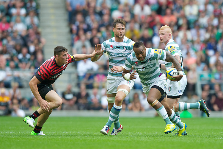 Sailosi Tagicakibau of London Irish accelerates past Joel Tomkins of Saracens during the Aviva Premiership match between Saracens and London Irish at Twickenham on Saturday 1st September 2012 (Photo by Rob Munro)