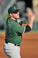 First baseman Skyler Ewing (25) of the Augusta GreenJackets warms up before a game against the Greenville Drive on Thursday, June 9, 2016, at Fluor Field at the West End in Greenville, South Carolina. Augusta won, 8-2. (Tom Priddy/Four Seam Images)