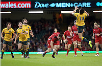 Pictured: Alex Cuthbert of Wales (C) is tripped down by Adam Ashley-Cooper of Australia (R) who jumps for the ball Saturday 08 November 2014<br />