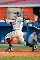 Jeff Flagg #27 of the Kingsport Mets follows through on a solo home run in the 5th inning versus the Burlington Royals at Burlington Athletic Park July 3, 2009 in Burlington, North Carolina. (Photo by Brian Westerholt / Four Seam Images)