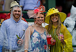 LOUISVILLE, KY - MAY 05: Spectators pose for a photo as they brave the sudden storm outside on Kentucky Derby Day at Churchill Downs on May 5, 2018 in Louisville, Kentucky. (Photo by Eric Patterson/Eclipse Sportswire/Getty Images)