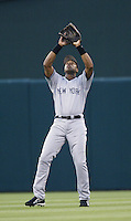 Bernie Williams of the New York Yankees waits under a fly ball during a 2002 MLB season game against the Los Angeles Angels at Angel Stadium, in Anaheim, California. (Larry Goren/Four Seam Images)