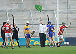 The umpire raises the green flag for Cork after consulting with the referee late during the Munster Senior game at Pairc Ui Chaoimh. Photograph by John Kelly.