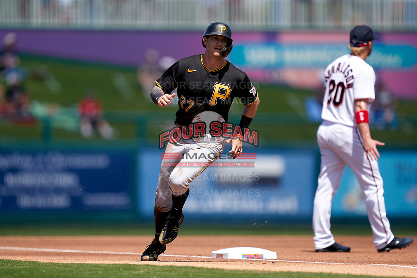 Pittsburgh Pirates Kevin Newman (27) round third base during a Major League Spring Training game against the Minnesota Twins on March 16, 2021 at Hammond Stadium in Fort Myers, Florida.  (Mike Janes/Four Seam Images)