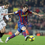 Football Season 2009-2010. Barcelona's player Lionel Messi (R) scoring second goal during the spanish liga soccer match at Camp Nou stadium in Barcelona. January 16, 2010.