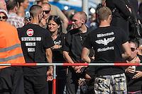 """Neonazis und Hooligans demonstrieren gegen Angela Merkel.<br /> Unter dem Motto """"Merkel muss weg"""" zogen ca. 1.200 am Samstag den 30. Juli 2016 mit einer Demonstration durch Berlin. Der Aufmarsch war vom einschlaegig bekannten Neonazi-Hooligan Enrico Stubbe angemeldet worden.<br /> Die Polizei hatte die Aufmarschroute der Rechten weitraeumig abgesperrt.<br /> Die Rechten forderten in Sprechchoeren immer wieder """"Nationalen Sozialismus! Jetzt!"""" (ein strafrechtlicher Trick, gemeint ist der Nationalsozialismus), beschimpften waehrend ihres Aufmarsches permanent Gegendemonstranten """"Wir kriegen euch alle"""" und """"Hurensoehne"""" und die Medienvertreter """"Luegenpresse"""". Mitarbeiter der Sicherheitsbehoerden erklaerten, dass es eindeutig ein rechtsextremer Aufmarsch gewesen sei bei dem sich keinerlei buergerliche Teilnehmer beteiligt haetten. Der Berliner Chef des Landesamt fuer Verfassungsschutz war persoenlich vor Ort um sich einen Eindruck zu verschaffen.<br /> Im Bild Neonazis aus Mecklenburg mit NPD-Shirt und einem T-Shirt mit dem Reichsadler aus dem Nationalsozialismus.<br /> 30.7.2016, Berlin<br /> Copyright: Christian-Ditsch.de<br /> [Inhaltsveraendernde Manipulation des Fotos nur nach ausdruecklicher Genehmigung des Fotografen. Vereinbarungen ueber Abtretung von Persoenlichkeitsrechten/Model Release der abgebildeten Person/Personen liegen nicht vor. NO MODEL RELEASE! Nur fuer Redaktionelle Zwecke. Don't publish without copyright Christian-Ditsch.de, Veroeffentlichung nur mit Fotografennennung, sowie gegen Honorar, MwSt. und Beleg. Konto: I N G - D i B a, IBAN DE58500105175400192269, BIC INGDDEFFXXX, Kontakt: post@christian-ditsch.de<br /> Bei der Bearbeitung der Dateiinformationen darf die Urheberkennzeichnung in den EXIF- und  IPTC-Daten nicht entfernt werden, diese sind in digitalen Medien nach §95c UrhG rechtlich geschuetzt. Der Urhebervermerk wird gemaess §13 UrhG verlangt.]"""