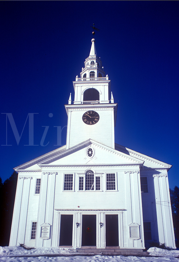 New England white wooden church with clock