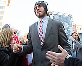 Doyle Somerby (BU - 27), Brien Diffley (BU - 20) - The teams walked the red carpet through the Fan Fest outside TD Garden prior to the Frozen Four final on Saturday, April 11, 2015, in Boston, Massachusetts.