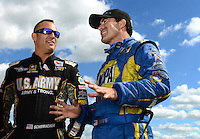 Sept 8, 2012; Clermont, IN, USA: NHRA top fuel dragster driver Tony Schumacher (left) talks with funny car driver Ron Capps during qualifying for the US Nationals at Lucas Oil Raceway. Mandatory Credit: Mark J. Rebilas-
