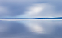 On a sunny spring day, Yellowstone Lake can present some wonderful landscape photography opportunities. Here, I played with long exposure motion blurs.