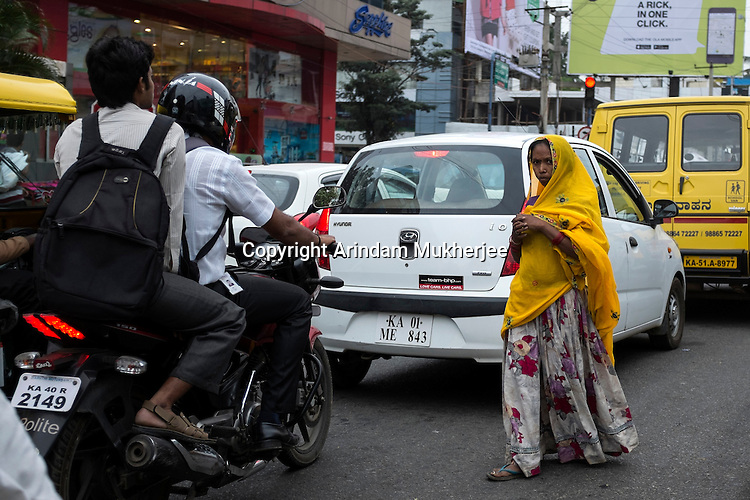 A begger trying her luck on a street in Bangalore, India.