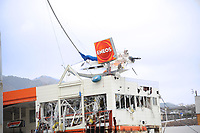 A fishing boat sits atop a gas station in downtown Ofunato after being swept there by a massive tsunami that devastated this Japanese fishing port.  An 8.9-magnitude earthquake triggered a devastating tsunami that ripped through this coastal city. Teams from the United States, United Kingdom and China arrived here to assist in searching for missing residents.